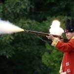 British soldier firing rifle