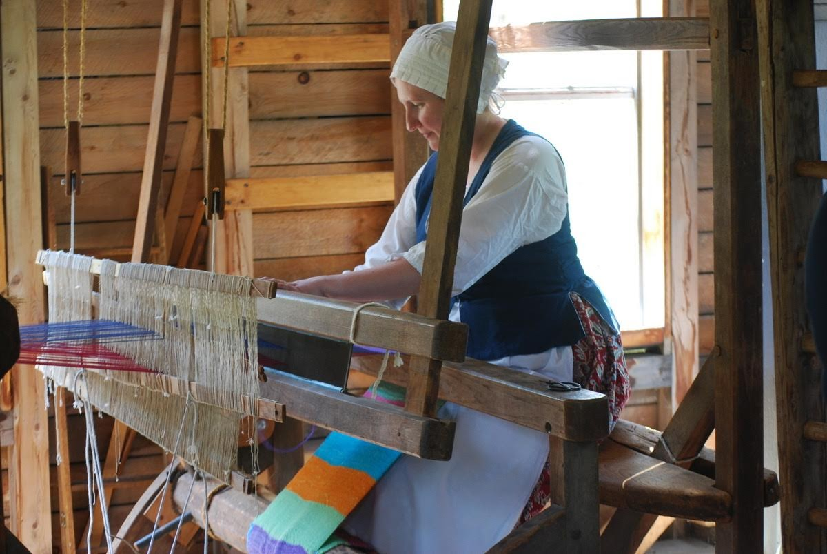 Woman weaving.